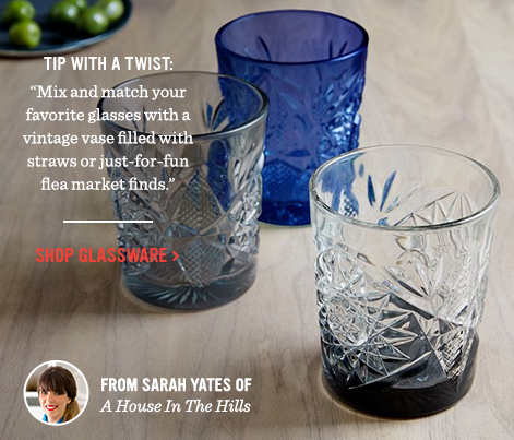 """Tip With A Twist: """"Mix and match your favorite glasses with a vintage vase filled with straws or just-for-fun flea market finds."""" - Shop Glassware"""