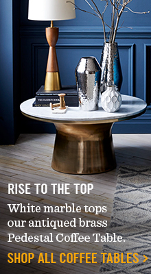 Rise To The Top - White marble tops our antiqued brass Pedestal Coffee Table.