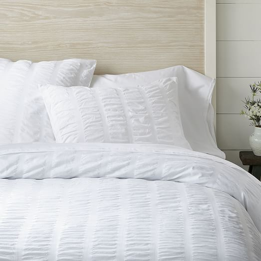 The INK+IVY Sutton Duvet Cover Set shows off subtle stripes in dark, medium, and light blue amidst a white seersucker background. The different stripe widths and richly varied colors give this clean look a visually pleasing dimension.
