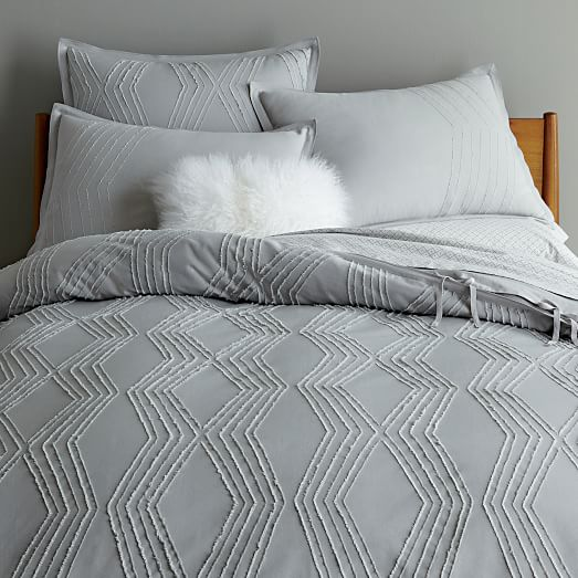 The range incudes a jacquard duvet cover and oxford pillowcase woven in a fine thread count cotton, reversing to a coordinating plain thread count percale. The range is accessorised with an embroidered cushion featuring the iconic Strawberry Thief design and a .
