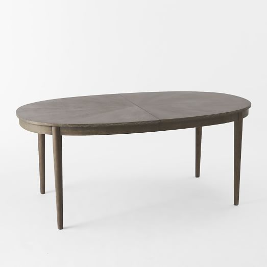 Starburst expandable dining table west elm for Expandable dining table