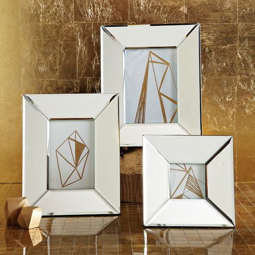 Mirror with photo frames